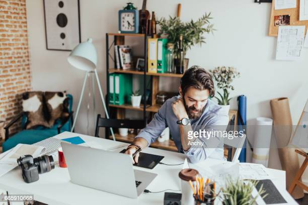 Young photographer working in his home office