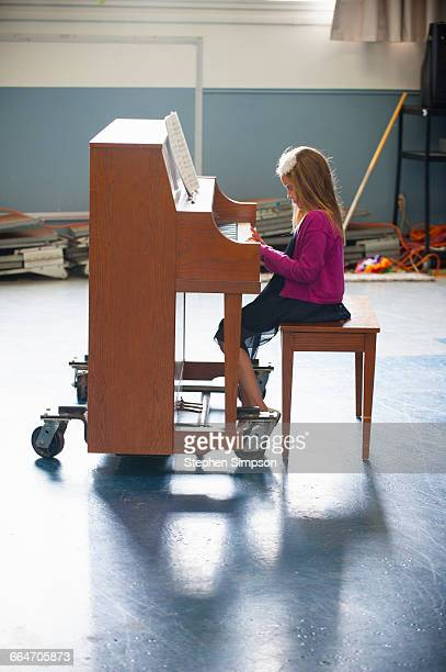 young piano student practicing intently
