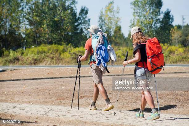 young pilgrims with rucksack in the 'camino de santiago' - santiago de compostela stock pictures, royalty-free photos & images