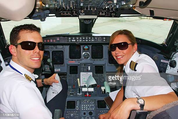Young pilots flaying in cockpit of commercial jet