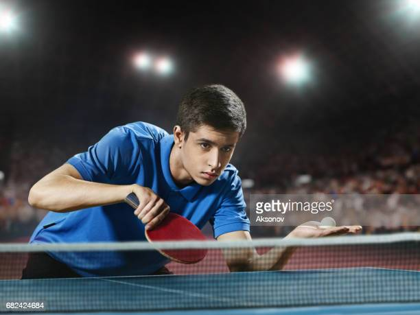 Young ping pong player playing table tennis game