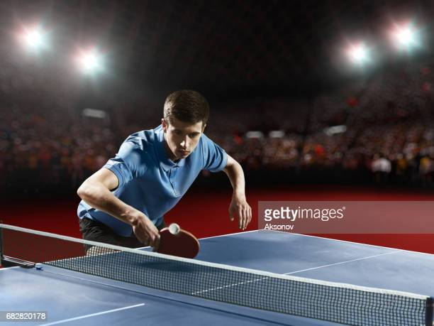 young ping pong player playing table tennis game - table tennis stock pictures, royalty-free photos & images