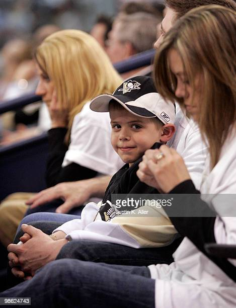 A young Pittsburgh Penguins fan stays up late during the second overtime period between the Pittsburgh Penguins and the Ottawa Senators in Game Five...