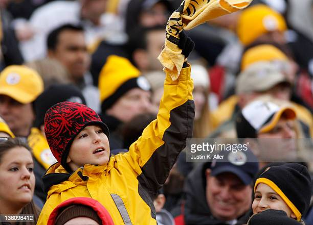 A young Pittsburgh Steelers fan waves his terrible towel during the game against the St Louis Rams on December 24 2011 at Heinz Field in Pittsburgh...