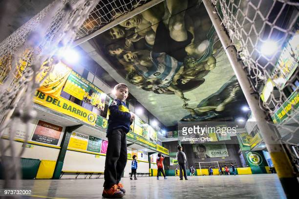 A young player guards the net at Sportivo Pereyra de Barracas club on June 13 2018 in Buenos Aires Argentina The mural was painted in the ceiling of...