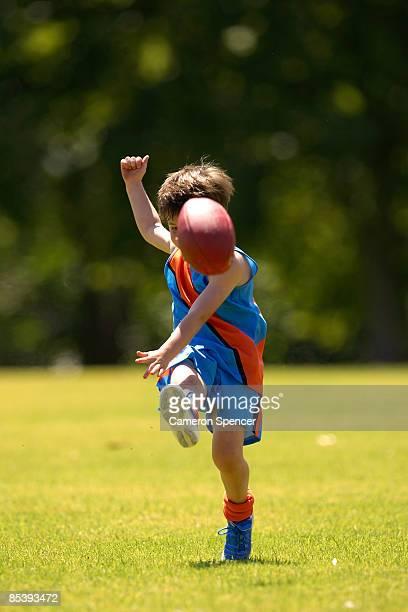 Young player kicking ball towards camera