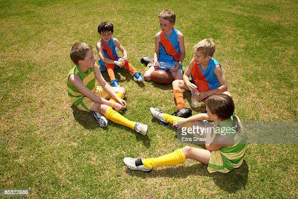 Young players chatting in a group