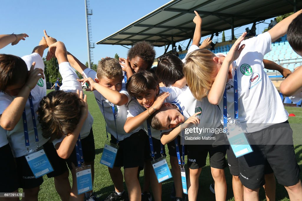 Young players dab as they pose for a photo during the Italian Football Federation during 9th Grassroots Festival at Coverciano on June 18, 2017 in Florence, Italy.
