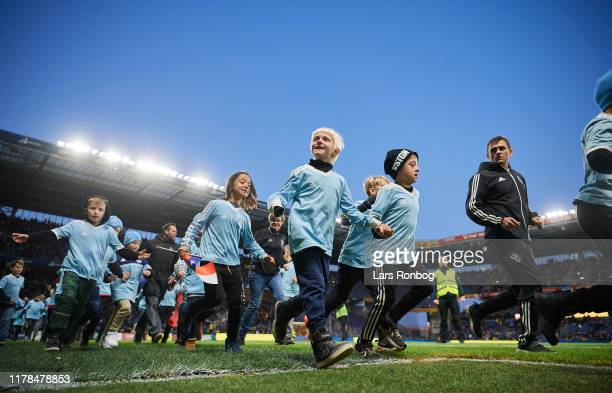 Young players from friendship clubs of Brondby IF cheering during halftime in the Danish 3F Superliga match between Brondby IF and Randers FC at...