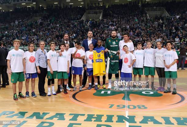 Young players of Panathinaikos BC Academy stand alongside with Special Olympics athletes during a One Team action that takes place during the...
