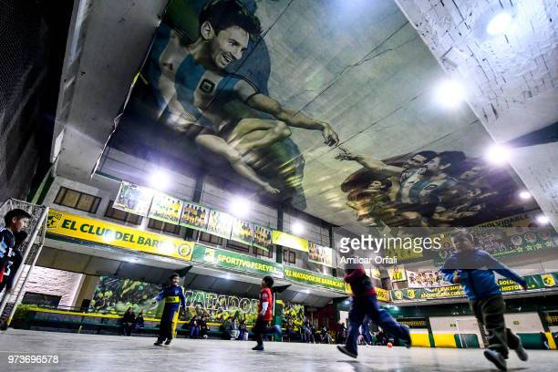 Young players practice at Sportivo Pereyra de Barracas Club on June 13 2018 in Buenos Aires Argentina The mural was painted in the ceiling of the...