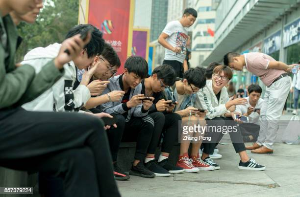 Young players practice outside the shopping mall where a battle match of mobile game Arena of Valor is held Arena of Valor 5v5 Arena Game China's...