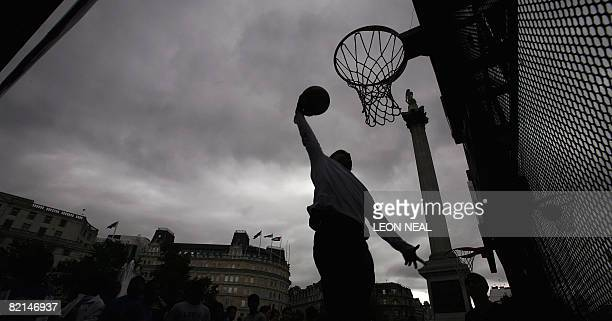 Young players practise their slamdunks during an NBA JamVan press event in Trafalgar Square in London on August 1 2008 British forward Luol Deng...
