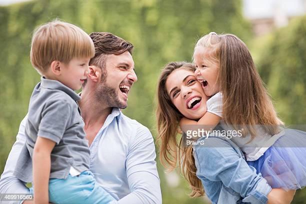 Young playful family having fun outdoors.