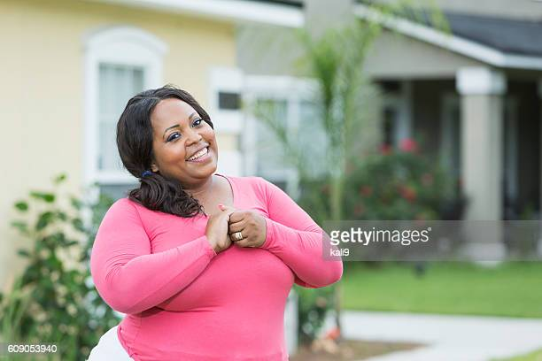 young, plus size african american woman outside house - images of fat black women stock photos and pictures