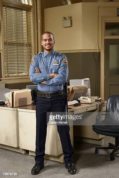 Young policeman in office, portrait