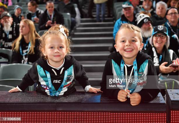 Young Port fans during the round eight AFL match between the Port Adelaide Power and the Adelaide Crows at Adelaide Oval on May 08, 2021 in Adelaide,...