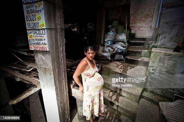 A young pregnant Brazilian woman poses in Santa Marta a slum located at Morro Dona Marta officially part of the district of Botafogo on October 20...