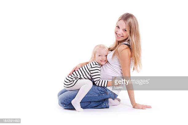 Young pregnant mother with her little baby