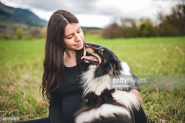 young pregnant woman and her dog outdoors - collie stock photos and pictures