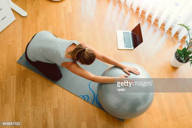 Young Pregnant Woman Exercises At Home