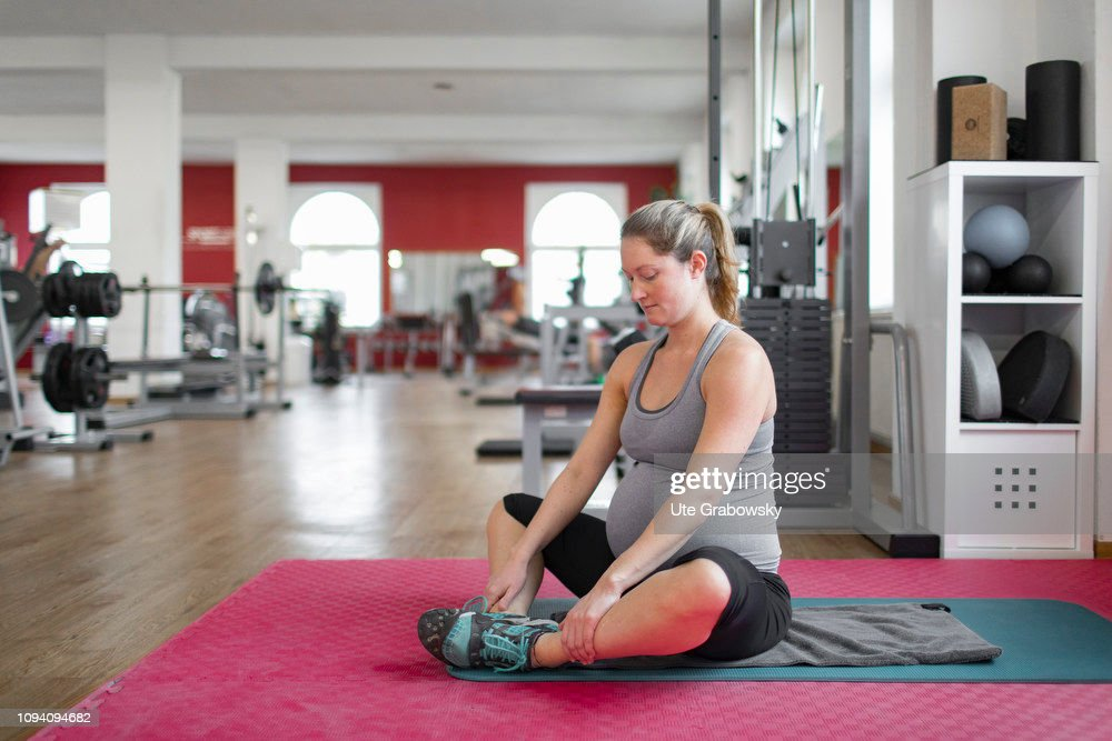 Young pregnant woman training in a gym, on January 24 ...