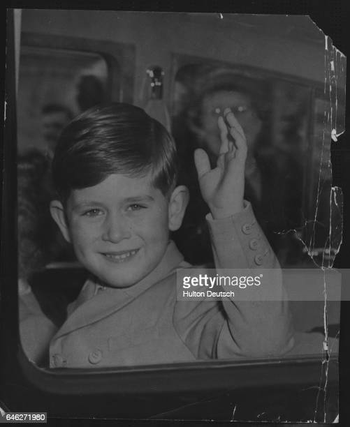 A young Prince Charles waves to the crowd as he leaves Buckingham Palace for Tobruk where he will be reunited with his parents