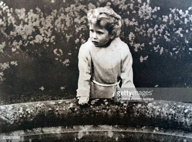 A Young Princess Elizabeth later Queen Elizabeth II stands on a bridge in the Glamis Castle in Scotland where both Princesses grew up