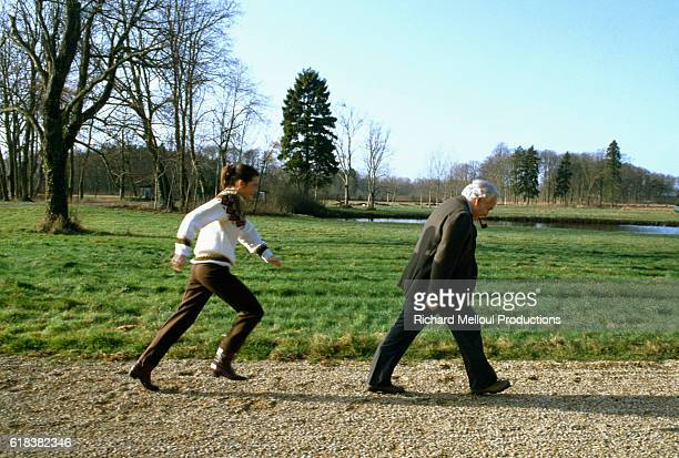 Young Princess Stephanie of Monaco runs after her father Prince Rainier III at the royal Grimaldi family's French villa Two months earlier Princess...