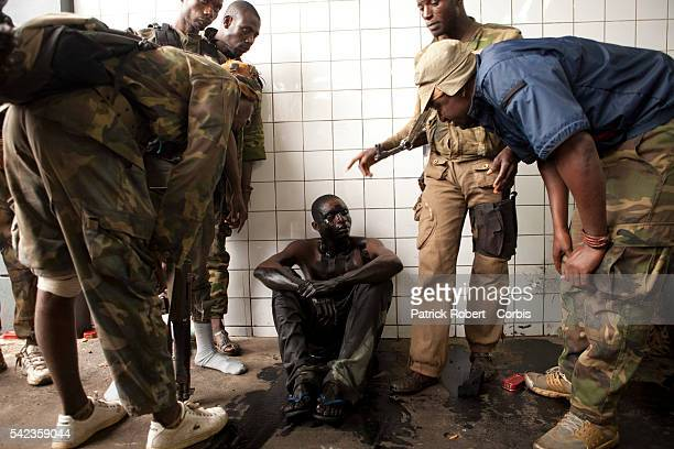 Young prisoners accused to be supporters of the army of Laurent Gbagbo have been sprayed with used oil to intimidate them Ivory Coast Republican...