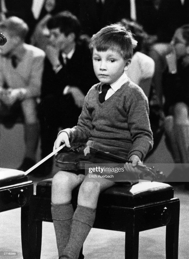 Young prodigy violinist Nigel Kennedy, a pupil of Yehudi Menuhin, waits his turn to perform.