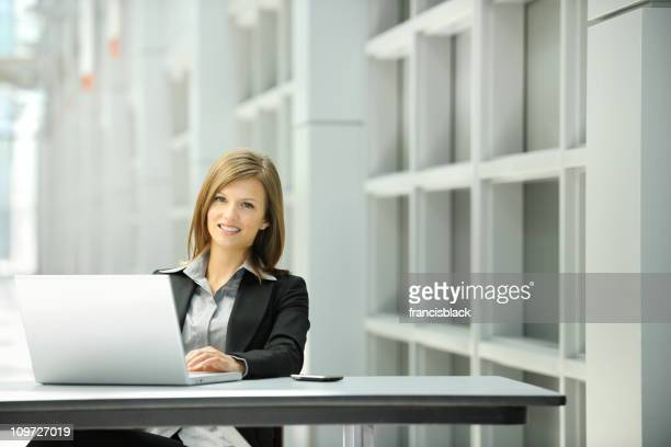 young professional businesswoman with laptop