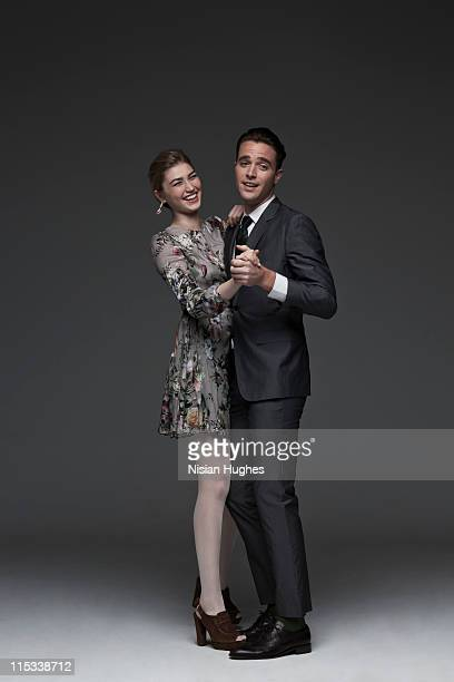 young professional couple dancing together