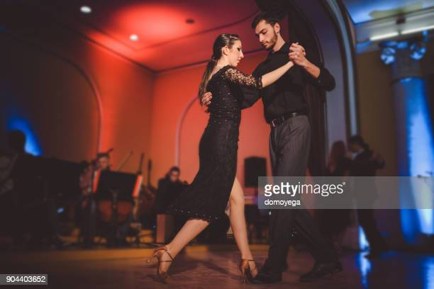 young professional dancers performing with an orchestra - tango dance stock photos and pictures
