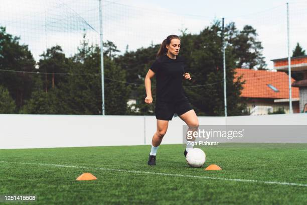 young professional female athlete training soccer - shooting at goal stock pictures, royalty-free photos & images