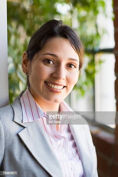 Young professional woman by office window