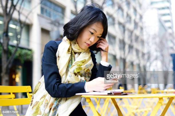 young professional working outside - prejudice stock pictures, royalty-free photos & images