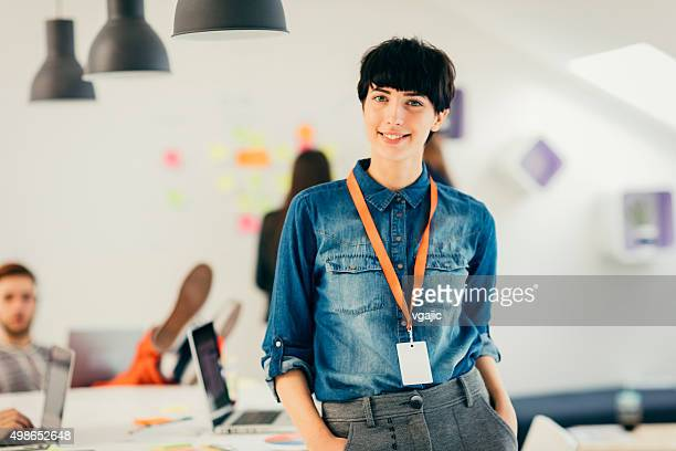 young programmers in her start-up office. - name tag stock photos and pictures