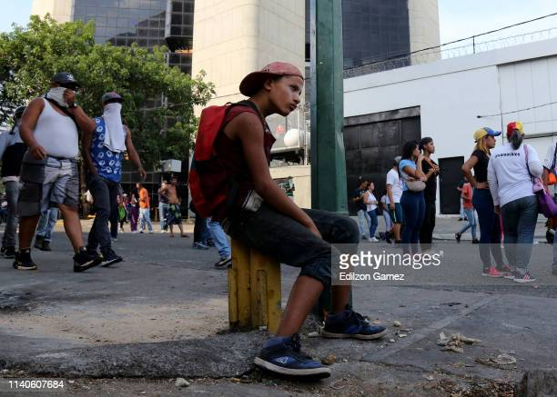A young proJuan Guaidó protester sits down after the May 1 demonstration near Plaza Altamira on May 1 2019 in Caracas Venezuela Yesterday Venezuelan...