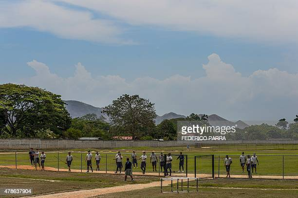 Young prospects attend a training session at the US Detroit Tigers baseball academy belonging to the Venezuelan Summer League in Guacara 120 km west...
