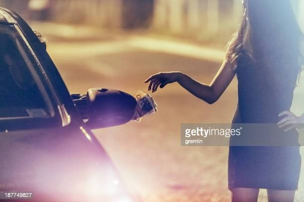 young prostitute on the street at night - hoeren stockfoto's en -beelden