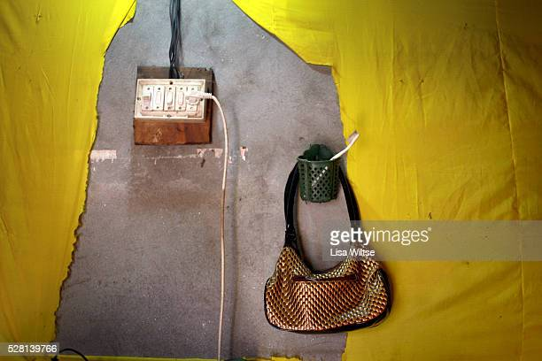 A young prostitutes handbag hangs on the wall along with her toothbrush in her sparse room which she uses to service clients Daulatdia brothel is the...