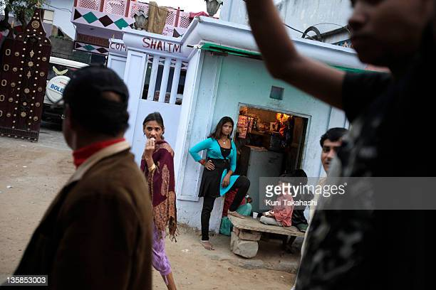 Young prostitutes many are from Ingonia wait for customers in a red light district November 17 2009 in Tilawada Rajasthan India Ingonia a small...