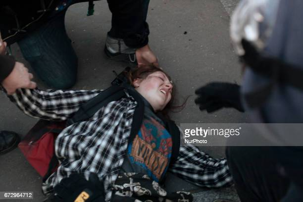 A young protester is quickly assisted after she fell and hurt herself during a panic moment where police forces tried to disperse the protesters...
