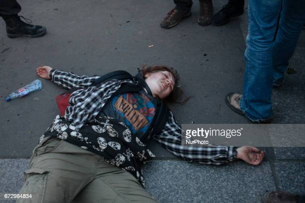 A young protester is seen lying in the floor after she fell and hurt herself during a panic moment where police forces tried to disperse the...