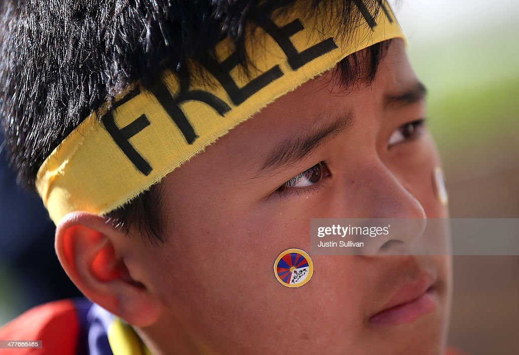 A young protester looks on during a demonstration outside of San Francisco City Hall on March 10, 2014 in San Francisco, California. Hundreds of activists marked the 55th anniversary of the 1959 Tibetan uprising and the fifth anniversary of Tibetan self-immolation protests in Tibet.