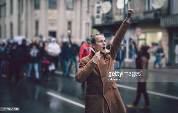 young protester - demonstration stock pictures, royalty-free photos & images