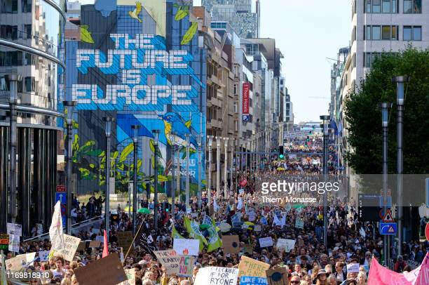 Young protesters hold up banners and chant during the third edition of the 'Global Strike For Future' Belgium march to raise awareness for climate...