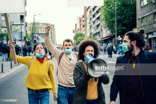 young protesters - campaigner stock pictures, royalty-free photos & images