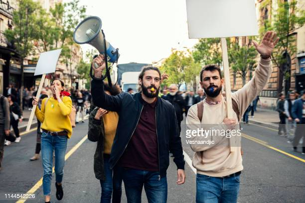 young protesters - demonstration stock pictures, royalty-free photos & images